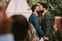 Thumb_men-wearing-suit-kissing-in-front-of-people-3491999-1024x682